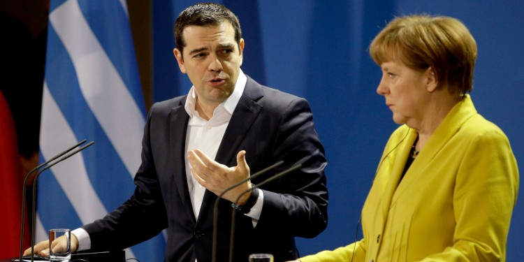 German Chancellor Angela Merkel, right, and the Prime Minister of Greece Alexis Tsipras address the media during a press conference as part of a meeting at the chancellery in Berlin, Germany, Monday, March 23, 2015. (AP Photo/Michael Sohn)